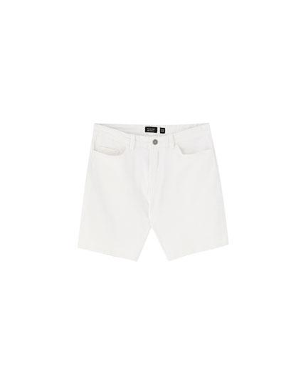 Coloured denim Bermuda shorts