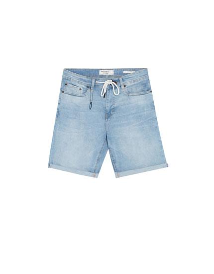 Light blue skinny denim Bermuda shorts