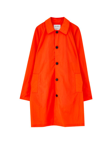 Orange buttoned trench coat
