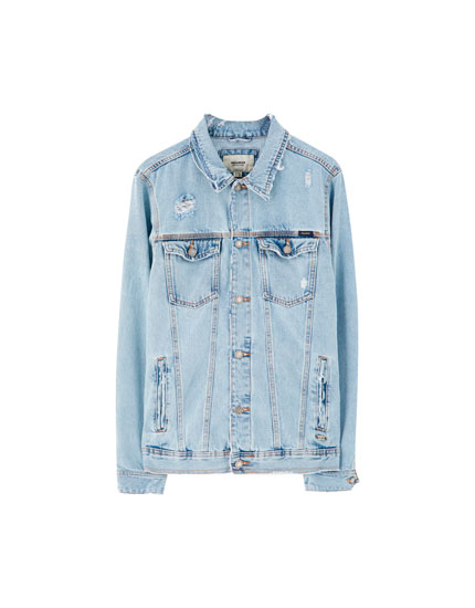 Ripped denim jacket with pockets