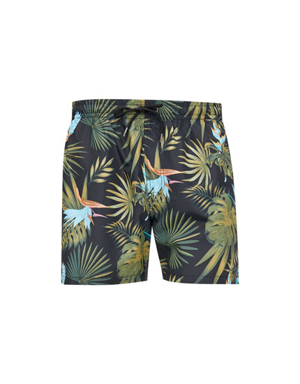 Leaf print Bermuda swim trunks