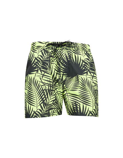 Yellow leaf print board shorts