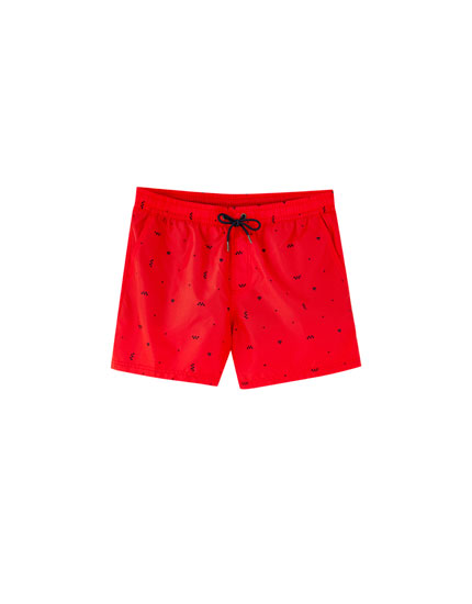 All-over print swimming trunks