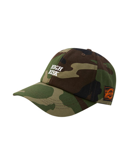 Camouflage cap with slogan