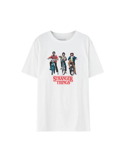 T-shirt Netflix Stranger Things med karaktererne på cykel