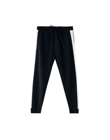 Pantalon jogging bande latérale chevilles bord côte