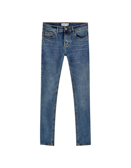 Jeans super skinny fit azul oscuro rotos