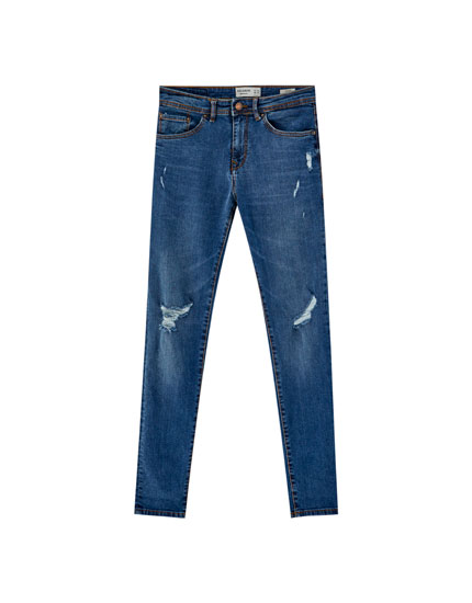 Jeans skinny fit con rotos