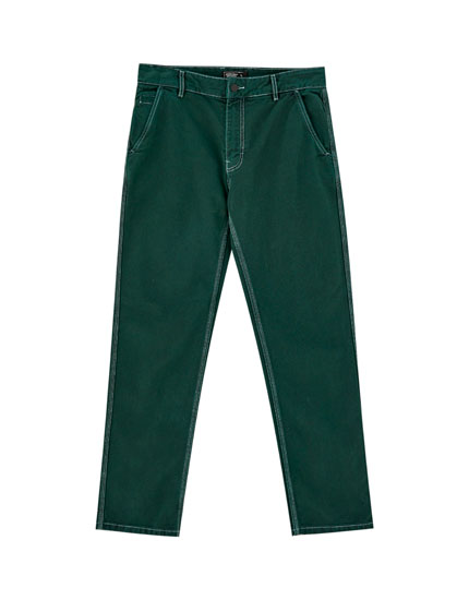 Green jeans with contrast seams