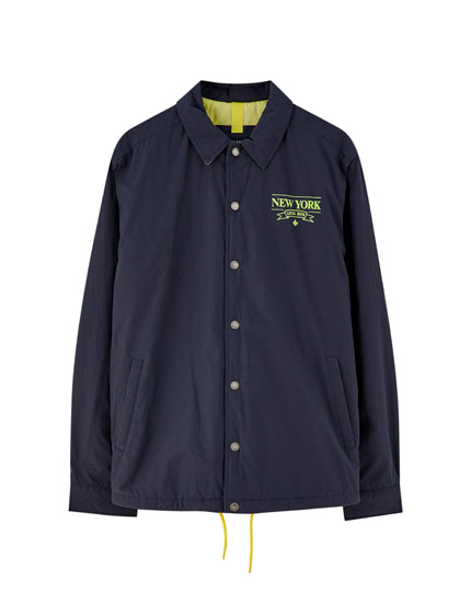 Navy blue coach jacket with neon detail