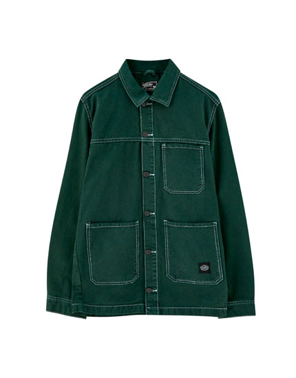 Green denim jacket with contrast seams