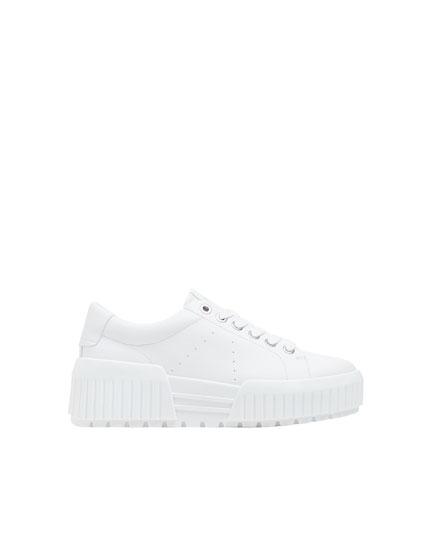 White trainers with platform soles