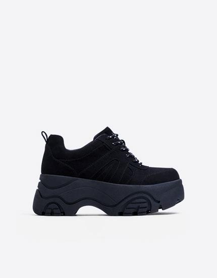 Black platform trainers