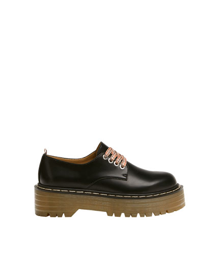 Black platform derby shoes