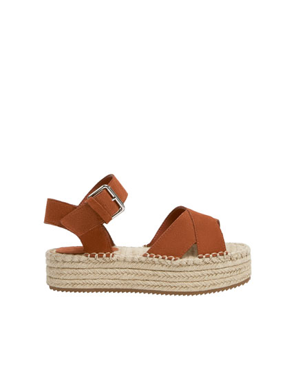 Jute wedge sandals with criss-cross leather straps