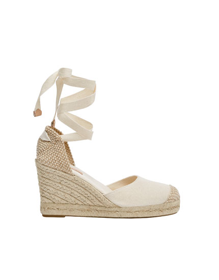 Beige tie-up jute wedges