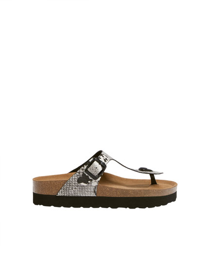 Sandals with snakeskin print straps