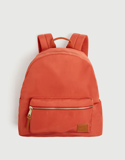 Orange fabric backpack