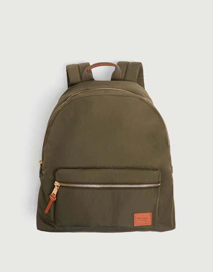 Green fabric backpack