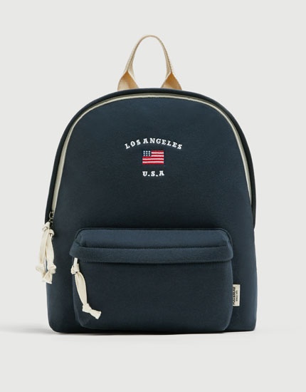 Blue backpack with flag detail