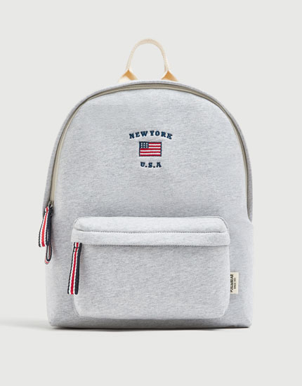 Grey backpack with flag detail