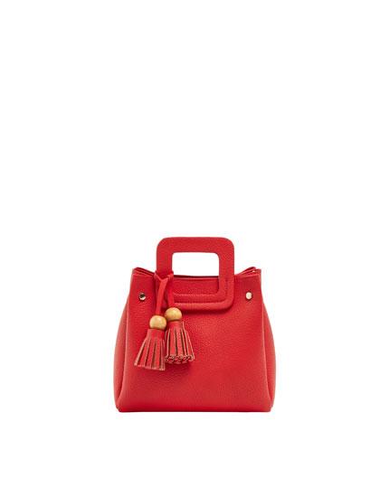 Rød mini-skuldertaske med kvastdetalje