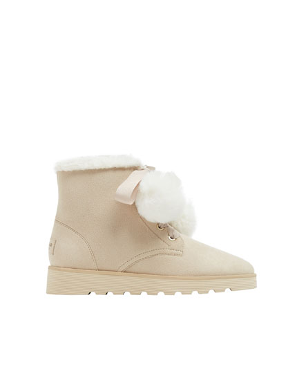 Beige winter ankle boots with pompoms