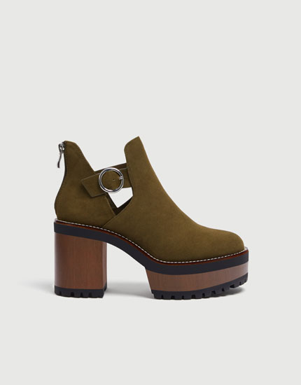 Green block heel ankle boots