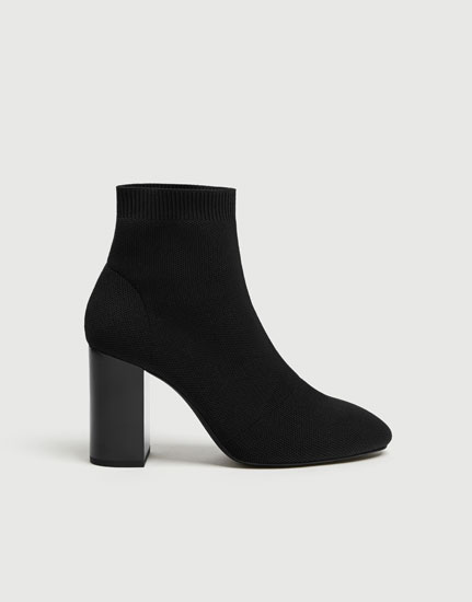 Black fabric high-heel ankle boots