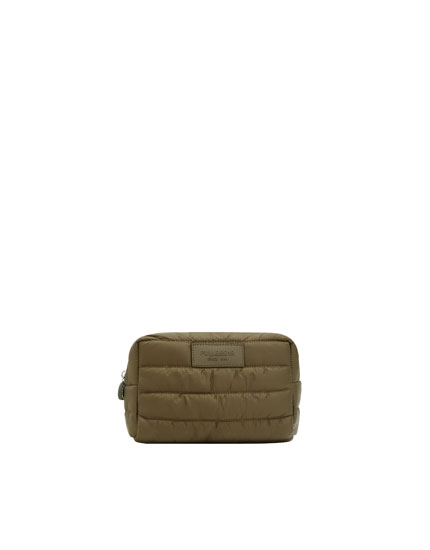 Quilted green toiletry bag