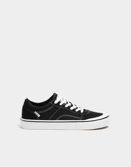 Teen black trainers