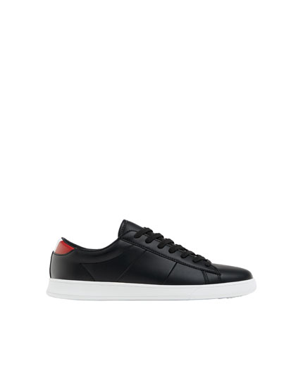 Black trainers with heel detailing