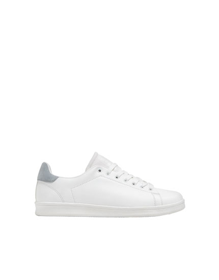 White trainers with heel detailing
