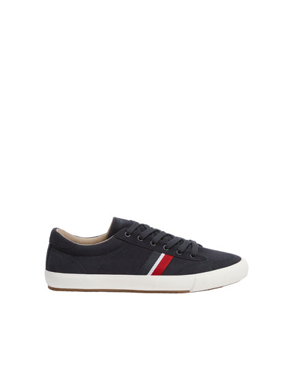 Coloured stripe plimsolls