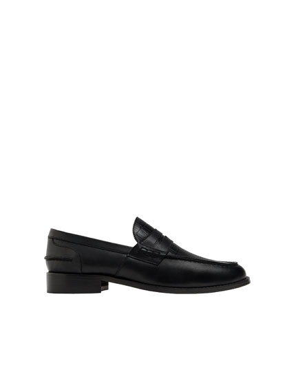 Black embossed loafers