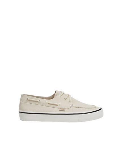 White canvas deck shoes