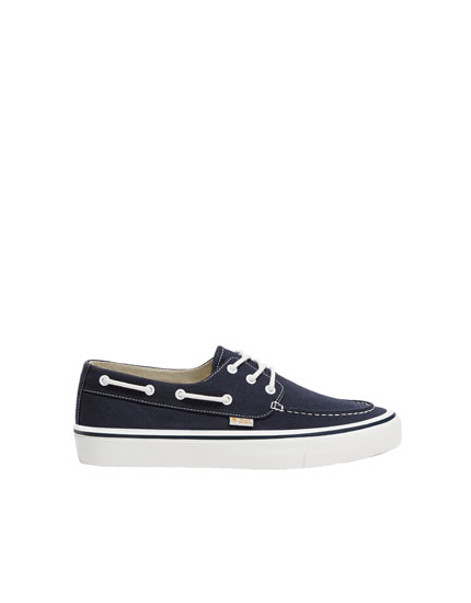 Blue canvas deck shoes