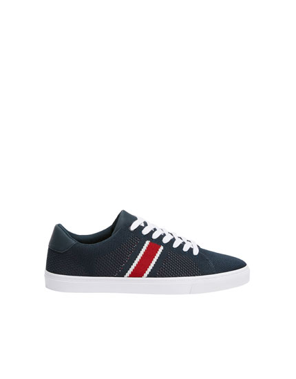 Blue trainers with knit stripe