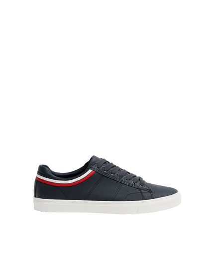 Trainers with striped ankle trim