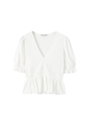Blouse with shirred detail and ruffle hem