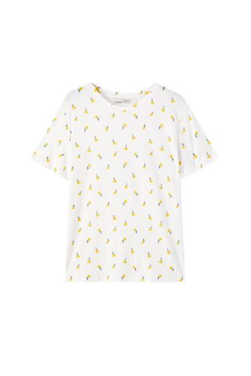 T-shirt blanc imprimé fleurs jaunes