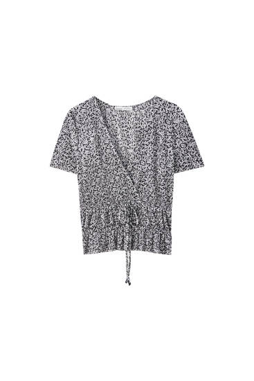 Pleated crossover top with elastic detail