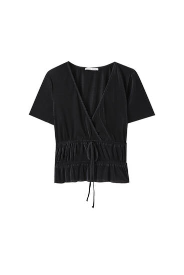 Pleated surplice top with elastic detail