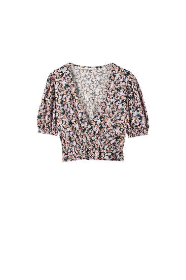 Printed surplice blouse with elastic trim