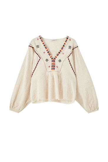Beige blouse with contrast embroidery