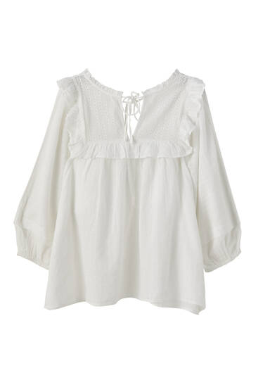 White ruffled blouse with tie detail