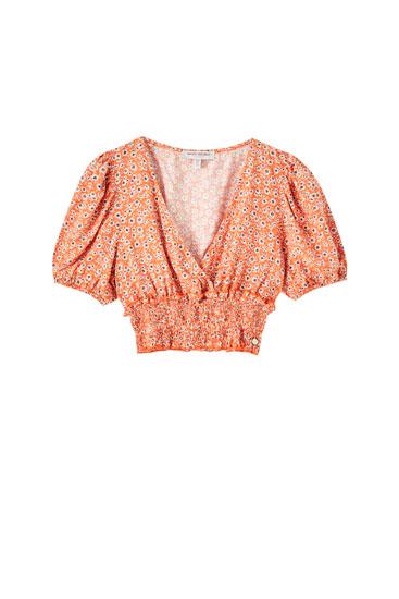 Orange shirred floral top