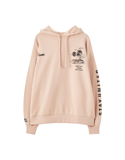 Pink hoodie with illustration and slogan