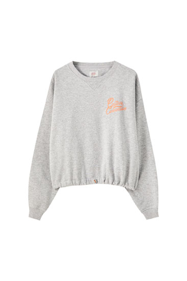 Cropped grey sweatshirt with elasticated hem