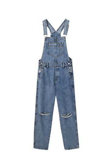 Denim dungarees with ripped knees